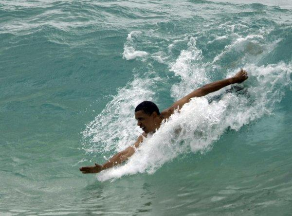 Then-Sen. Barack Obama body surfs while vacationing in Hawaii during the 2008 presidential race.