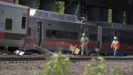Federal investigators gathered Saturday at the site of the Connecticut train crash that left dozens of commuters injured Friday evening.