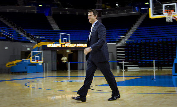 New UCLA Coach Steve Alford strolls across the Pauley Pavilion court to address the media.