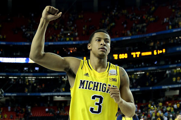 Trey Burke celebrates Michigan's 61-56 victory against Syracuse.