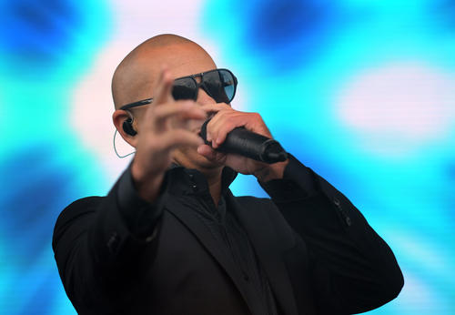 Pitbull performs on the main stage in the infield of Pimlico Race Course on Preakness day.