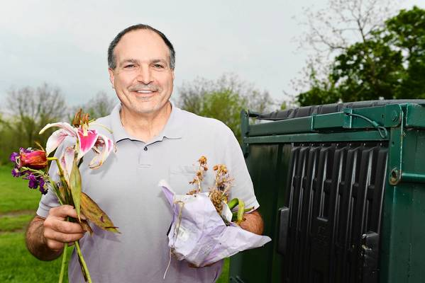 On the Cheap tipster Michael Ferraro goes Dumpster diving for bulbs at a cemetery.