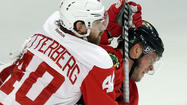 Wings play extra tough with Toews