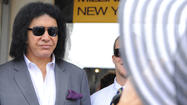 Kiss rocker Gene Simmons and actress/model wife Shannon Tweed caused quite a stir at Preakness 2013 when the two stopped by the Christine A. Moore Millinery tent in the corporate village of Pimlico Race Track.