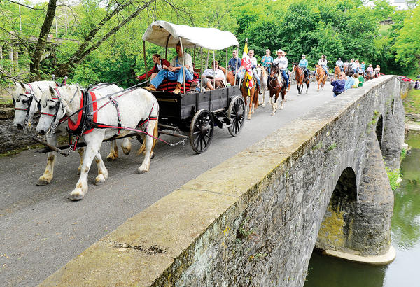 The National Pike Festival Wagon Train made it's way over the old Wilson Bridge Saturday morning during it's first day of travel.