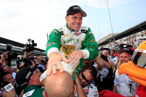 Ed Carpernter, driver of the #20 Fuzzy's Vodka/Ed Carpenter Racing Chevrolet, celebrates with crew members after qualifying on the Pole for the Indianapolis 500.