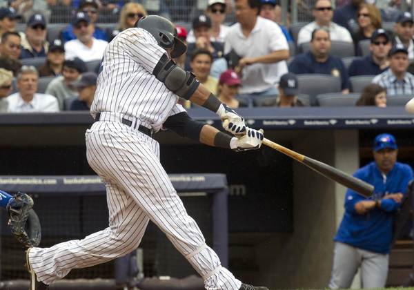 In the fifth inning, the Yankees' Robinson Cano hits his second home run of the game against the Toronto Blue Jays Saturday afternoon at Yankee Stadium. He also hit a two-run homer in the third inning.