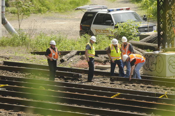 Officials inspect the track Saturday afternoon at the site of Friday's Bridgeport/Fairfield train derailment.