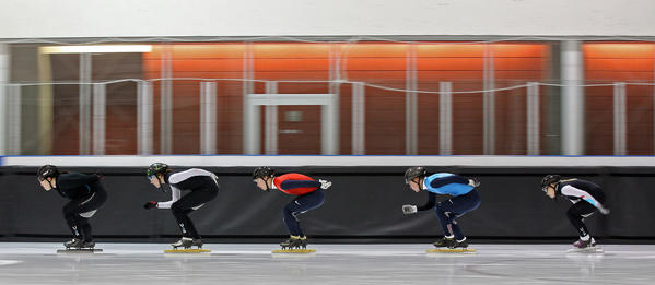 Speedskaters Tamara Frederick, Lana Gehring, Keith Carroll, Cole Krueger and Jessica Smith skate in unison during a morning training session at the Salt Lake City Sports Complex in January.