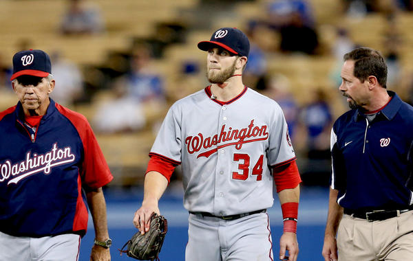 Washington Nationals right fielder Bryce Harper (34) walks off the field after running into the wall in the fifth inning.