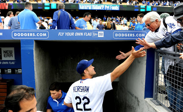 Dodgers' Clayton Kershaw celebrates a win on Opening Day with fans at Dodger Stadium.