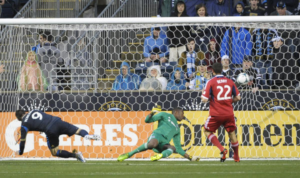 The Union's Jack McInerney scores goal against Fire goalkeeper Sean Johnson during the first half at PPL Park.