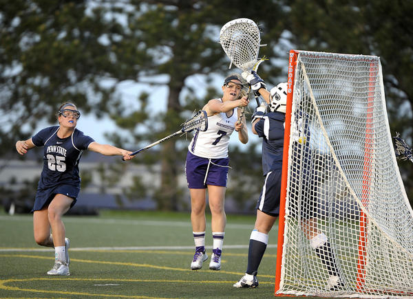 Northwestern's Erin Fitzgerald shoots and scores over Penn State goalie Emi Smith.