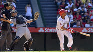 Angels rally then have to hang on to beat White Sox, 12-9