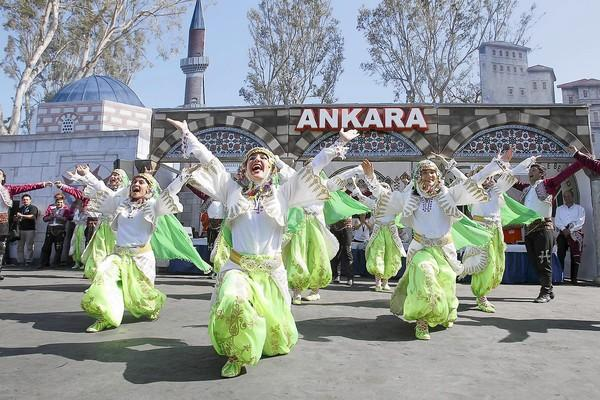 Tubil Turkish performers, from Ankara, Turkey, dance during the Anatolian Cultures & Food Festival at the Orange County Fairgrounds on Saturday.