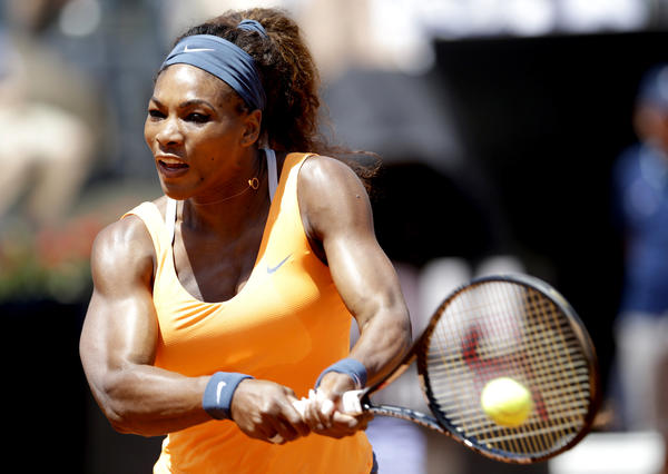 Serena Williams hits a return shot to Simona Halep during their semifinal match.