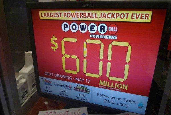 A monitor at a Bethesda, Md., gas station shows the expected jackpot for Saturday's Powerball drawing.