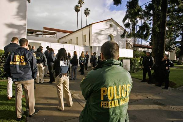 Federal agents descend upon the Bowers Museum in Santa Ana during a raid in January 2008 to seize allegedly illegally trafficked antiquities from Southeast Asia.