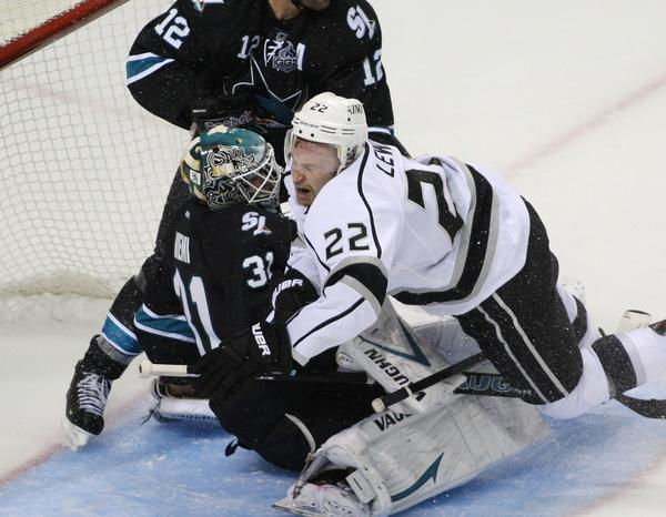 Kings' Trevor Lewis knocks over San Jose Sharks goaltender Antti Niemi in the third period of Game 3 in the Western Conference semifinals at HP Pavilion on Saturday.