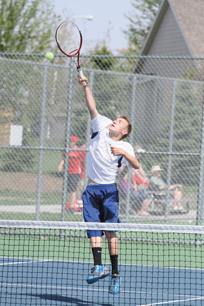 Aberdeen Centrals Alex Grandbois goes up for an overhead smash during the state boys tennis tournament last week. Grandbois took home a sixth-place finish in the tournament at flight-five singles.