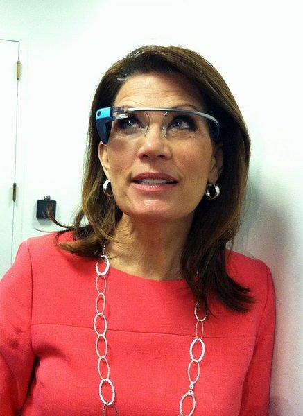 Rep. Michele Bachmann (R-Minn.) tries Google Glass after a meeting of the Republican Party caucus.