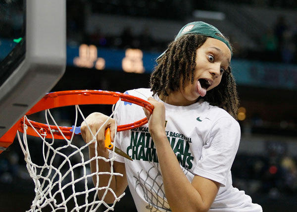 Baylor Bears' Brittney Griner smiles for photographers while cutting a piece of the net after they defeated the Notre Dame Fighting Irish in their women's NCAA Final Four championship college basketball game in Denver, Colorado, April 3, 2012.
