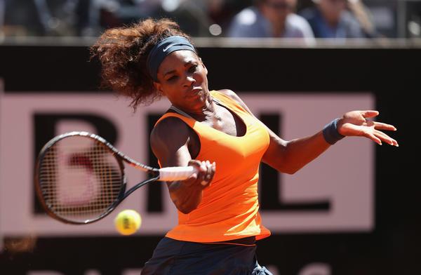 Serena Williams plays a forehand against Victoria Azarenka on Sunday.