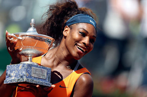 Serena Williams of the U.S. holds the trophy after winning the women's singles final match against Victoria Azarenka of Belarus at the Rome Masters tennis tournament May 19, 2013. Williams won 6-1 6-3.