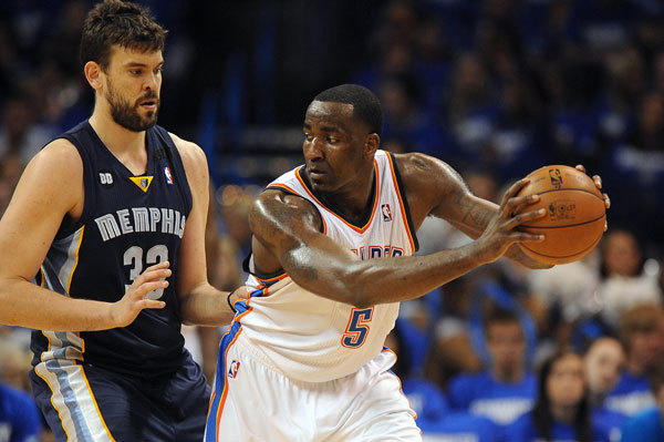 Oklahoma City Thunder center Kendrick Perkins (5) handles the ball against Memphis Grizzlies center Marc Gasol (33) during the second half in game one of the second round of the 2013 NBA Playoffs at Chesapeake Energy Arena. The Thunder defeated the Grizzlies 93-91.