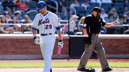 New York Mets first baseman Ike Davis is batting only .156 in 39 games this season, but he was assured by general manager Sandy Alderson that he will not be sent to the minors.