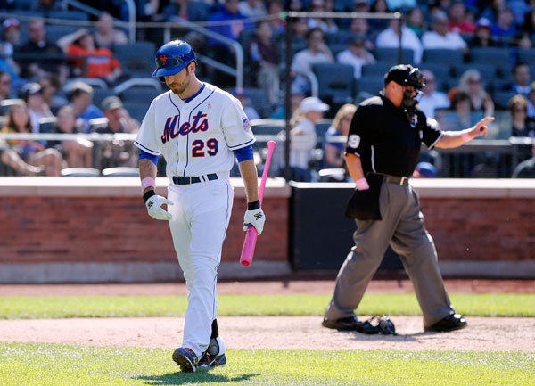 New York Mets first baseman Ike Davis (29) reacts after striking out in the eighth inning with two men on base against the Pittsburgh Pirates at Citi Field.