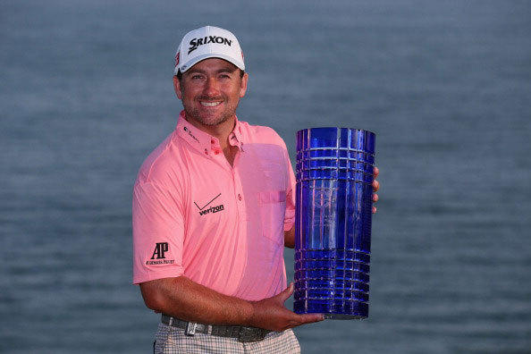 Graeme McDowell of Northern Ireland poses with the trophy after winning the Volvo World Match Play Championship at Thracian Cliffs Golf & Beach Resort on May 19, 2013 in Kavarna, Bulgaria.