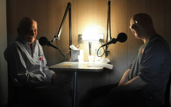 Ben Zuber, left, is interviewed by son Aaron, right, in the StoryCorps recording booth installed in the Chicago Cultural Center.