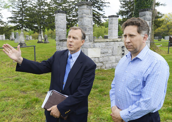 Hagerstown-Washington County Convention and Visitors Bureau President and CEO Tom Riford, left, gestures while speaking about the new GAR memorial to be placed at Rose Hill Cemetery this fall to honor black Civil War soldiers. At right is Steve Bockmiller who designed the memorial.