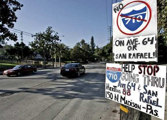 Signs opposing the 710 Freeway being built on Ave. 64 were placed at the corner of Church St. and Ave. 64 in Pasadena. (Raul Roa/Staff photographer / August 8, 2012)