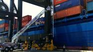 A Port Everglades worker was hospitalized after he was hit by a cargo container Sunday afternoon, Broward Sheriff Fire Rescue said.