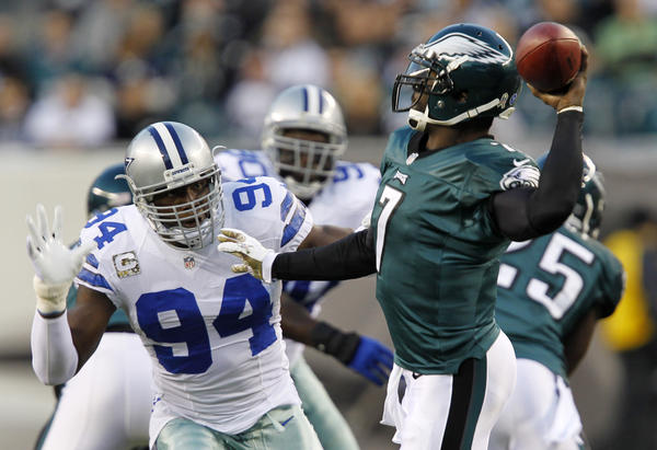 The Cowboys' DeMarcus Ware pressures Eagles quarterback Michael Vick to throw in the first quarter at Lincoln Financial Field.