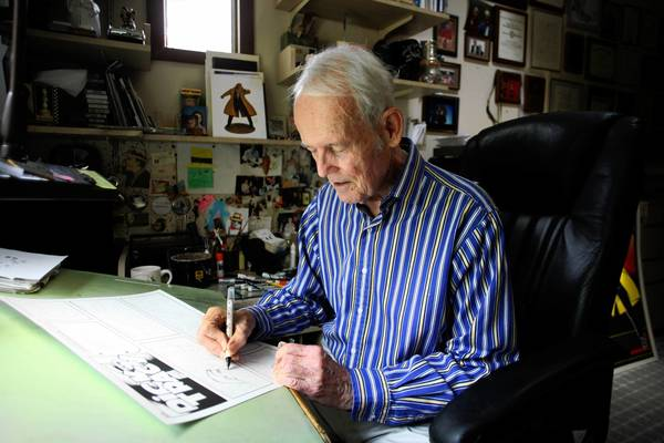 Dick Locher, who worked on the Dick Tracy comic strips and as a cartoonist for the Chicago Tribune, works in his Naperville home in 2009. He recently announced his retirement after 40 years of cartooning.