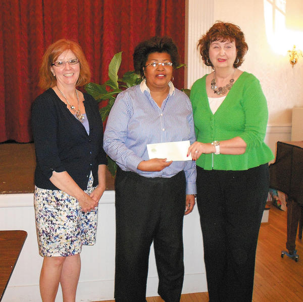 Delrose Jackson, center, receives the Women's Club Foundation Scholarship. She is shown with Kristy Smith, left, Community Foundation programs and communications manager, and Donna Smith, president of the Women's Club of Hagerstown.