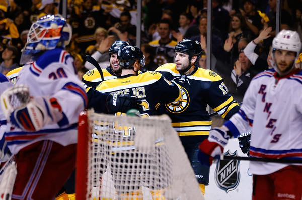 Milan Lucic (17) is congratulated by Bruins teammates after scoring in the third period against the Rangers in Game 2 of the Eastern Conference semifinals Sunday in Boston.