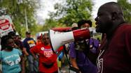 Beads of sweat dripped down Jitu Brown's face as he addressed about 150 marchers who had gathered on Sunday afternoon outside Overton Elementary School in Chicago's Bronzeville neighborhood.