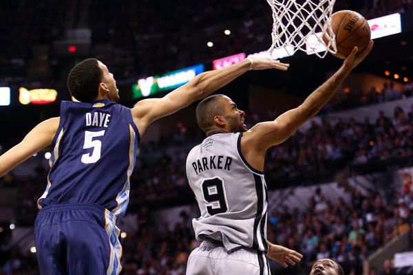 The Spurs' Tony Parker drives in the second half against the Grizzlies' Austin Daye.