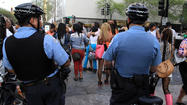 Chicago police have charged 10 juveniles and 2 adults with misdemeanors after a large group blocked streets near the Gold Coast Saturday evening, officials said today.