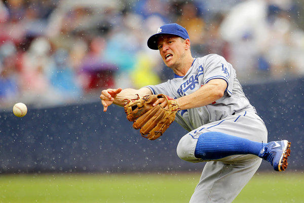 Dodgers' Mark Ellis throws to first base during a game against the Atlanta Braves Sunday.