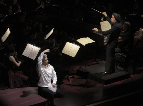 Gustavo Dudamel conducts the L.A. Phil and Edwin Crossley-Mercer, left, is Figaro.