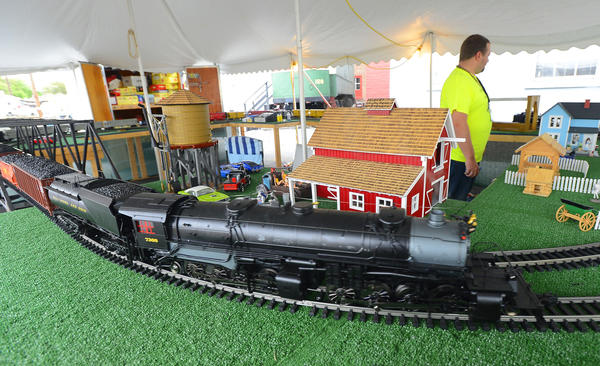 Hgerstown Roundhouse Museum member Shawn Poling ran several G-scale model trains Sunday afternoon during Railroad Heritage Days in Hagerstown.