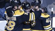 BOSTON -- The Boston Bruins' young defenseman has yet to panic through his first two playoff games.