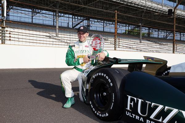 Indy Car Series driver and pole sitter Ed Carpenter poses for a photo before the start of bump day.