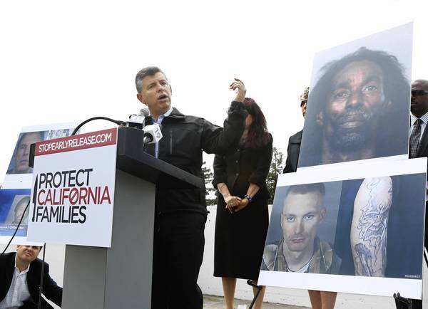 Abel Maldonado shows photos he said were of offenders who have committed crimes since early release from custody as he announced he would lead a campaign to ask voters to repeal the prison realignment plan. But accused murderer Jerome Anthony Rogers, pictured at top, has never been released early.