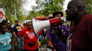 Beads of sweat dripped down Jitu Brown's face as he addressed about 150 marchers who had gathered Sunday afternoon outside Overton Elementary School in Chicago's Bronzeville neighborhood.